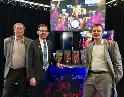 CIESIN director Robert Chen (left) stands with Lawrence Friedl, NASA, (middle) and Steffen Fritz, IIASA