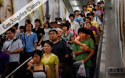 A five-part article examines the implications of world population growth beyond seven billion; SEDAC's Human Footprint data shows where Earth been most impacted.Beyond 7 Billion feature image showing chinese people crowded on an escalator